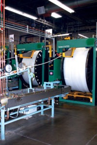 Left. Large coiling machines neatly wrap the recently manufactured PEX tubing into large rolls.
