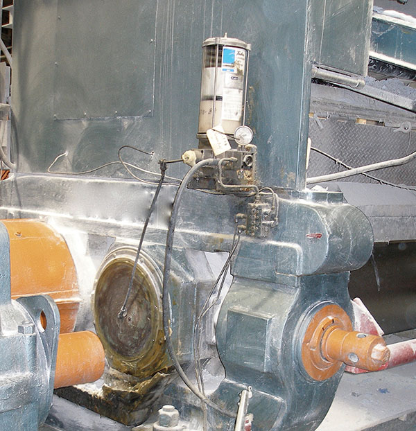This mechanically actuated grease pump uses a pitman-arm control connected to a large-diameter rotating-machine shaft. The shaft attachment point is offset from the center to produce a reciprocating arm motion that produces a rocking motion at the pump shaft. This emulates the back-and-forth motion of the manual lever arm. Photo: EngTech Industries Inc.