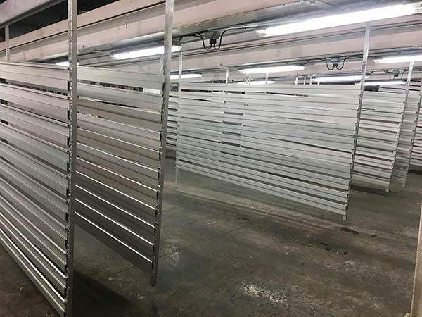 Material welded to load bars, prior to being anodized. Anodize racking carries the work load through the anodizing process and provides a secure electrical connection leading to the power supply during the anodizing steps.