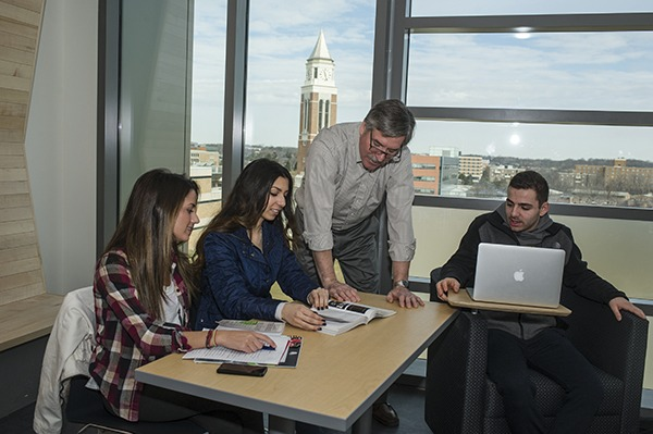 Program chair Robert Van Til works with students in the Industrial and Systems Engineering program.